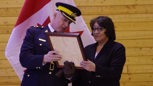 Celine Marlowe, now a teacher in Lutselk'e, N.W.T., receives the RCMP Commissioner's Commendation for Bravery for saving four other children from a fire in Fort Reliance when she was nine years old.