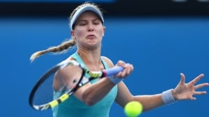 Montreal's Eugenie Bouchard hits a forehand return in Wednesday's 6-2, 7-6 victory over Virginie Razzano at Melbourne Park.