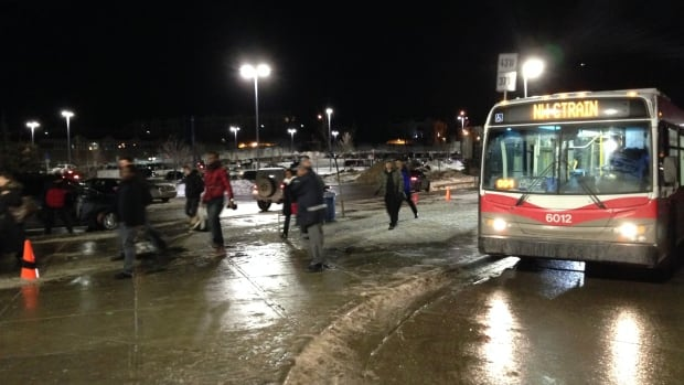 Calgary commuters take buses from Dalhousie station after C-Train service was disrupted Tuesday afternoon.