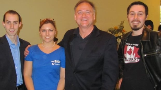 Former Guelph Conservative campaign worker Michael Sona, left, who is accused of making misleading robocalls in the 2011 federal election, with an unknown woman, Guelph Conservative candidate Marty Burke, second from right, and deputy campaign manager Andrew Prescott, right, in an undated photo.