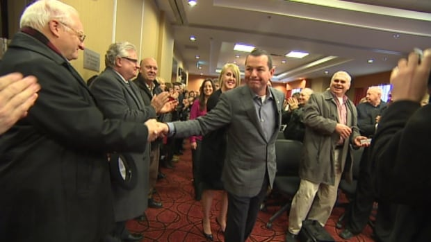 St. John's businessman Jim Burton greets supporters in St. John's on Wednesday.