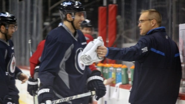 Blake Wheeler and new head coach Paul Maurice share a laugh at practice Wednesday.