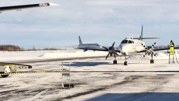 Two diverted aircraft sit at the Brandon airport on Wednesday after bad weather made it unsafe to land in Winnipeg.