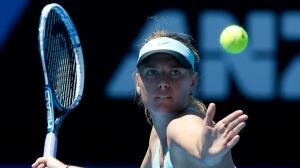 Maria Sharapova readies to hit a forehand return in a 6-3, 4-6, 10-8 victory over Karin Knapp at Melbourne Park on Thursday.