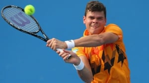 Milos Raonic of Thornhill, Ont., hits a backhand in a 7-6, 6-4, 6-4 victory over  Victor Hanescu at Melbourne Park on Thursday.