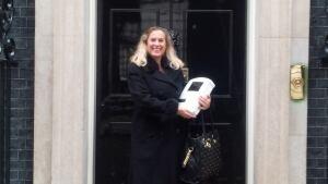 Elaine Warburton holds prototype
