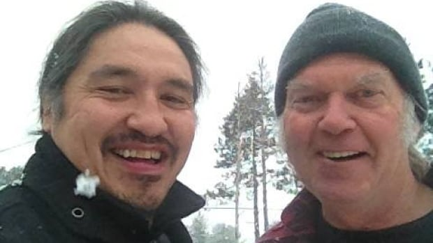 Chief Allan Adam, left, poses with Neil Young during the singer's recent Honour the Treaties tour. Adam says First Nations agreed to cancel a public meeting in Fort Chipewyan tonight, after Alberta health officials refused to release an advance copy of a report on cancer statistics that was to be the meeting's subject.
