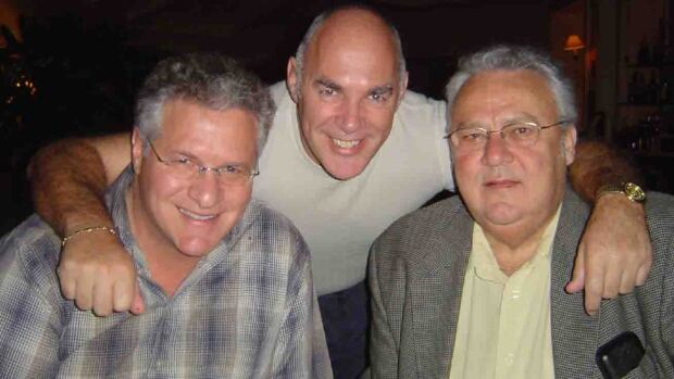 Former FTQ-Construction president Jean Lavallée, right, poses with entrepreneur Tony Accurso, left, and former FTQ-Construction executive director Jocelyn Dupuis in 2003.