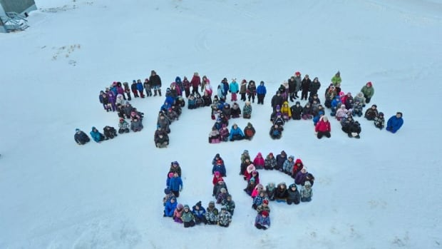 Children in Pangnirtung, Nunavut, send a message during an anti-bullying workshop in the community, as part of the Embrace Life Council's suicide prevention work in the territory. In 2013, 45 people took their lives in the worst year for suicide in the territory's history.