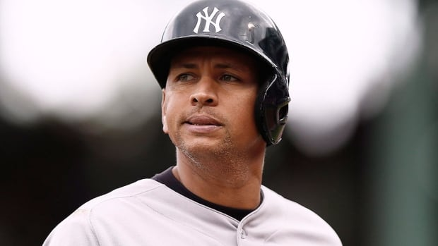 Yankees third baseman Alex Rodriguez, who is suspended for the 2014 season, says he wants to remain with the team and he'll begin a 'new chapter' in his life in 2015.