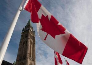 Parliament Hill flag Adrian Wyld Canadian Press