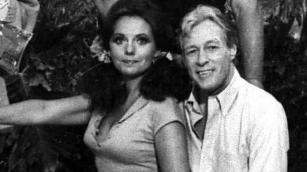 Russell Johnson is best remembered for his Gilligan's Island role as 'the Professor.' He's seen here with co-star Dawn Wells, who played Mary Ann.