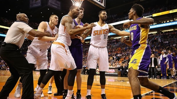 Lakers' guard Nick Young,right, reacts to a flagrant foul from Phoenix Suns' centre Alex Len, far left.