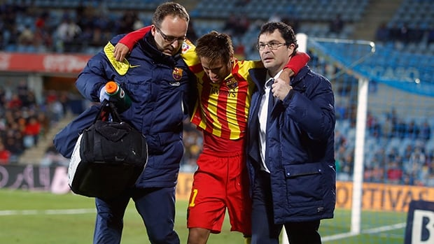 FC Barcelona's Neymar leaves the field injured during a the Copa del Rey match against Getafe in Madrid, Spain, Thursday, Jan. 16, 2014.