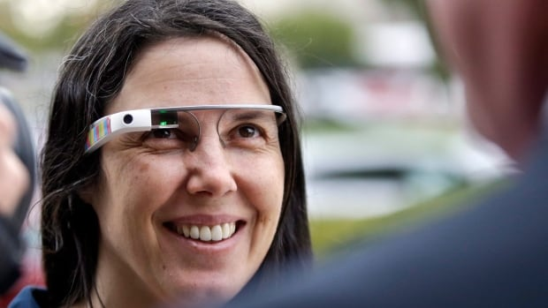 Cecilia Abadie wears her Google Glass as she talks with her attorney outside of traffic court on Dec. 3, 2013.