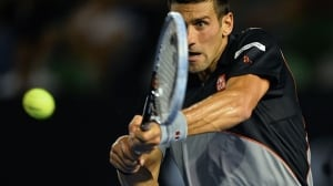 Second-seeded Novak Djokovic plays a shot during Friday's third-round win over Denis Istomin at Melbourne Park.