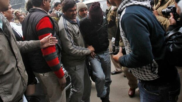 Police have arrested six homeless men accused of a gang rape outside a court in a popular tourist area in New Delhi.
