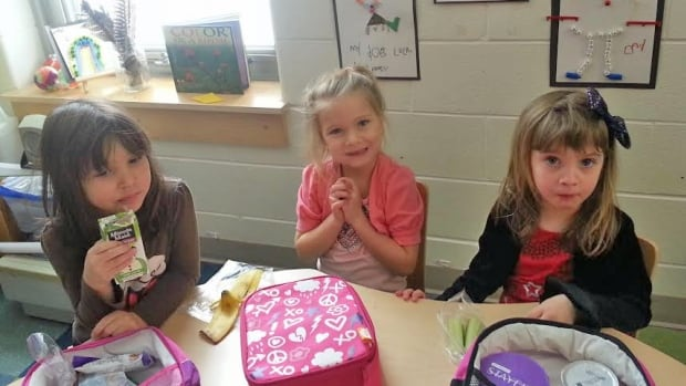 Kindergarten students Abbey Delamonadiere, Anika Harris and Elizabeth Elliott take a break at Princess Anne Public School in Sudbury.