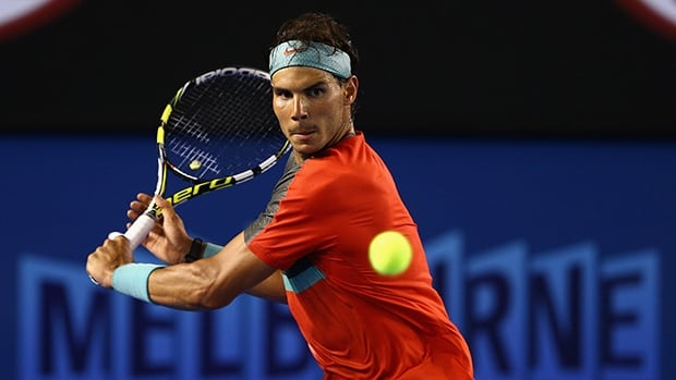 Rafael Nadal plays a backhand in his third-round match against Gael Monfils at Melbourne Park on January 18, 2014 in Melbourne, Australia.