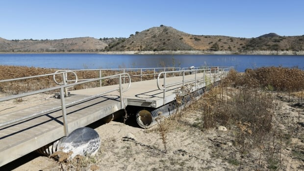 The receding water line of Lake Hodges is seen in San Diego County on Jan. 17, 2014. California Governor Jerry Brown declared a drought emergency on Friday, a move that will allow the parched state to seek federal aid as it grapples with what could turn out to be the driest year in recorded state history for many areas.