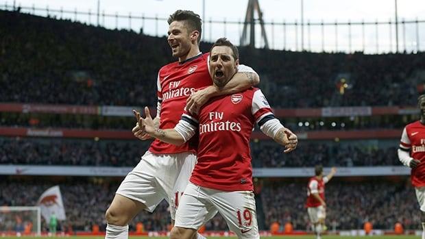 Arsenal's Santi Cazorla, right, celebrates scoring the opening goal against Fulham with teammate Olivier Giroud at the Emirates Stadium in London on January 18, 2014.