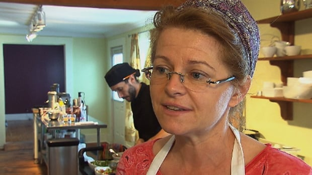 Marie-Josée Bégin says operating a vegetarian café means using a lot of water to rinse vegetables, fruits and sprouts. She says she's taken to bringing water from her own well because boiling water is too lengthy a process.