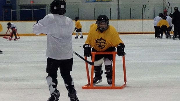 Twenty-six children play hockey at the Pioneer Arena on Logan Avenue Saturday. They were taking advantage of new donated gear they received from Hockey Manitoba and the Winnipeg Jets True North Foundation. It's the program's fourth year.