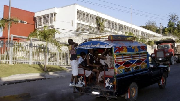 A local passenger bus passes the Canadian Embassy in Port-au-Prince, Haiti.