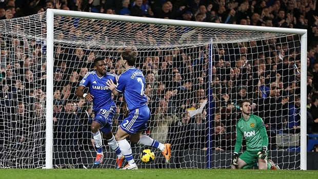 Chelsea's Samuel Eto'o, left, celebrates scoring his third goal against Manchester United at Stamford Bridge in London on January 19, 2014.