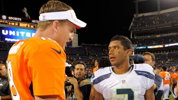 Denver Broncos quarterback Peyton Manning, left, shakes hands with Seattle Seahawks quarterback Russell Wilson following a Seattle win in 2012.