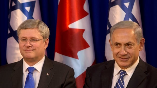 Israeli Prime Minister Benjamin Netanyahu, right, sits with Canadian Prime Minister Stephen Harper, during a welcoming ceremony at the Prime Minister's office in Jerusalem on Sunday during  Harper's official visit to the region.