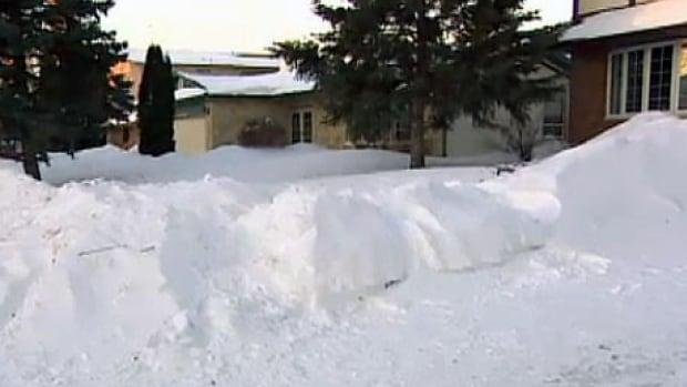 Neighbours rushed to dig out the nine-year-old boy after he was found buried in this collapsed snowbank.