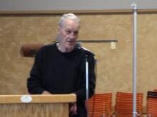 Bill Davies speaks to meeting
