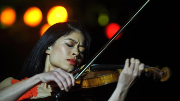 Pop-classical violinist Vanessa-Mae, seen performing in Prague in 2010, skis using her Thai father's surname, Vanakorn.