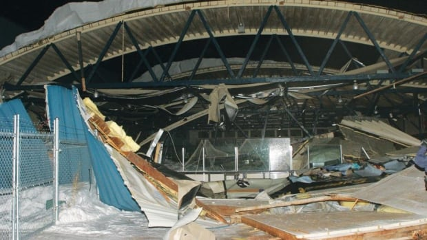 The roof collapsed on the old Sylvan Lake arena early this morning. An employee in the building at the time escaped unharmed.