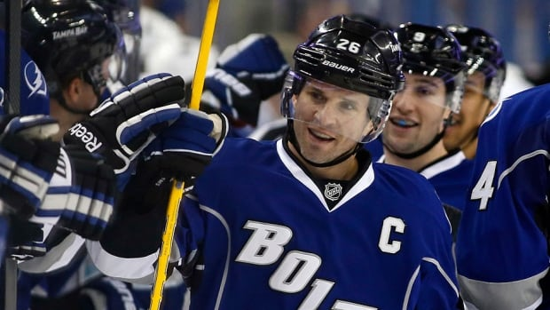 The Lightning's Martin St. Louis had five goals and eight points in four games to capture NHL first star honours for the week. On Saturday, he became only the second Tampa Bay player to score four times in a game in a 5-4 loss to San Jose.