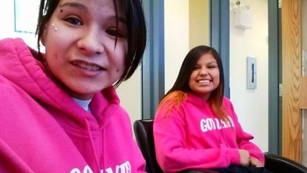 Bonita Daniels, left, and Tenelle Starr were sent to the principal's office after wearing 'Got land?' shirts to school.
