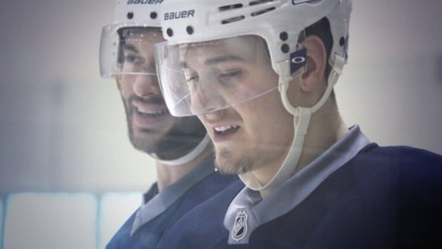 The Winnipeg Jets' Anthony Peluso and Mark Scheifele share a laugh at practice Monday at the MTS Iceplex.