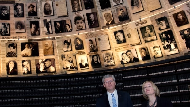 Prime Minister Stephen Harper and wife Laureen Harper look up at pictures of Holocaust victims at the Yad Vashem Holocaust Memorial in Jerusalem, Israel on Tuesday, January 21, 2014. THE CANADIAN PRESS/Sean Kilpatrick