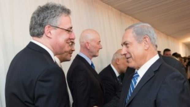 "Conservative MP Mark Adler, left, with Israeli Prime Minister Benjamin Netanyahu, had re-election on his mind Tuesday in front of Old Jerusalem's Western Wall as he pushed Prime Minister Stephen Harper's staff for the ""million-dollar shot"" with Harper."