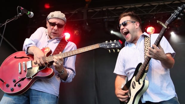 Tony D, left, and Steve Marriner of award-winning band MonkeyJunk are seen performing at the 2012 Ottawa Bluesfest. The group has once again dominated the annual Maple Blues Awards, taking five trophies on Monday.
