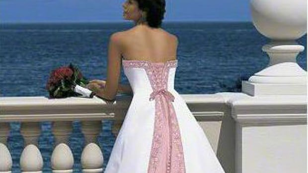 A Regina woman has listed a wedding dress on a classifieds website and will take a bottle of liquor as a trade.