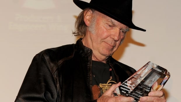 Canadian rock veteran Neil Young accepts his award at The Village Recording Studios in Los Angeles on Tuesday.