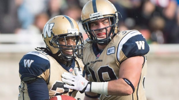 Winnipeg Blue Bombers Michel-Pierre Pontbriand (right) celebrates with teammate Will Ford, who scored a touchdown against the Montreal Alouettes during a game in October 2013.