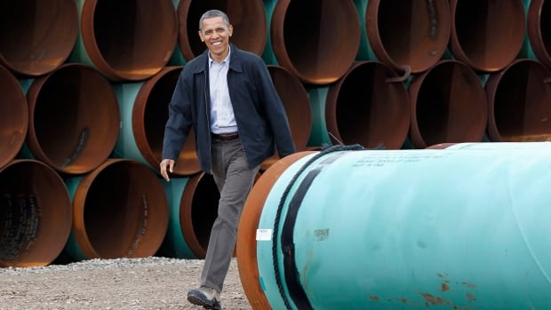 President Barack Obama is shown at the TransCanada Stillwater Pipe Yard in Cushing, Okla. A judge's ruling in Nebraska is muddying the legal status of Keystone and could further delay a decision.