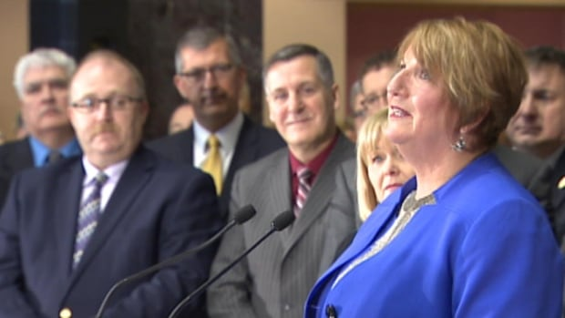 Members of the Progressive Conservative caucus watched Wednesday as Premier Kathy Dunderdale announced her decision to resign.