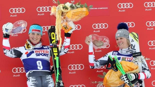 Austria's Elisabeth Goergl, left, enjoys the spoil on the podium with third placed countrywoman Nicole Hosp.