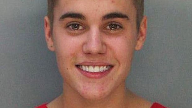 Justin Bieber smiles for his mug shot at the Miami Dade County Corrections Department on Jan. 24, after he was arrested for alleged street racing.