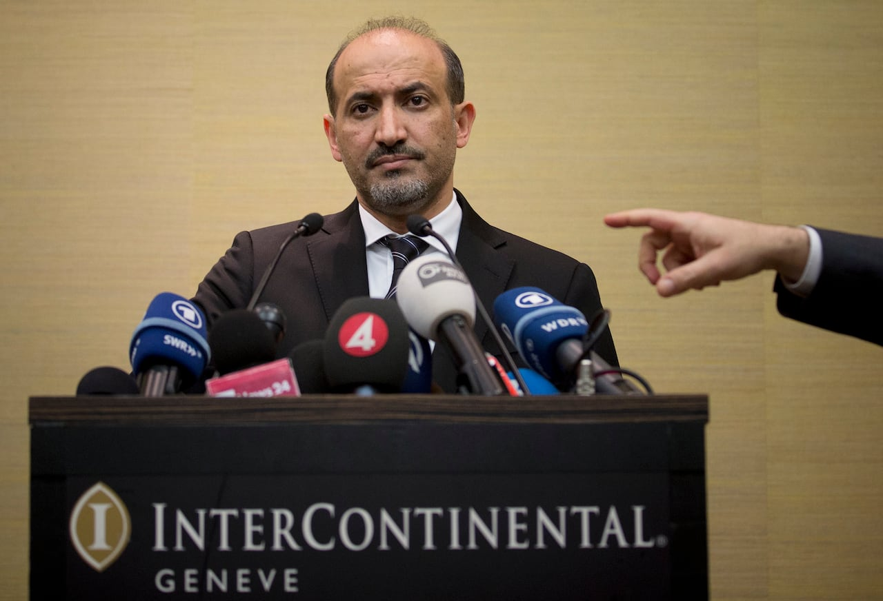 Ahmad al-Jarba, leader of the Syrian National Coalition (SNC), Syria's main political opposition group, answers questions during a press conference in Geneva, Switzerland, Thursday, Jan. 23, 2014.