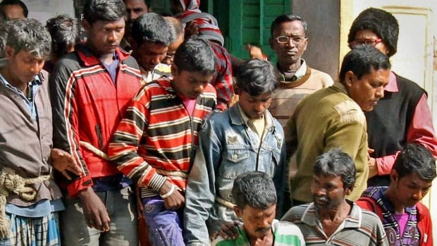 Thirteen men arrested in the Monday night gang rape of a woman are produced at a court in Bolpur, West Bengal state, India on Thursday.